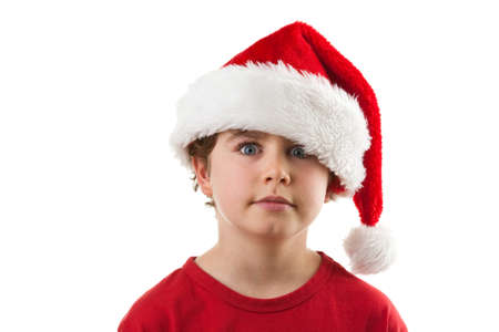 10s: Boy wearing a santa hat Stock Photo