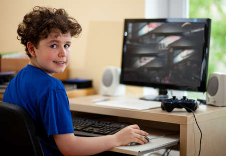 Boy playing a computer game photo