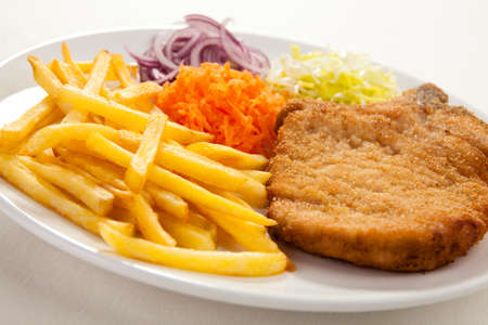 Chicken chops and fries photo