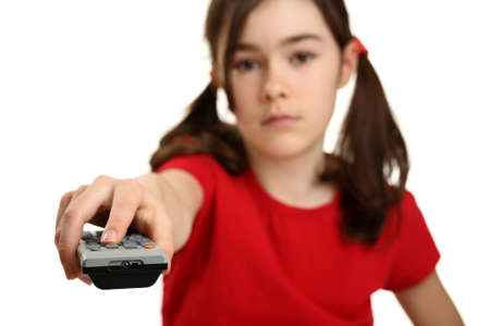 sound off: Girl using remote control isolated on white background