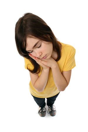 Girl standing and pretending to sleep Imagens