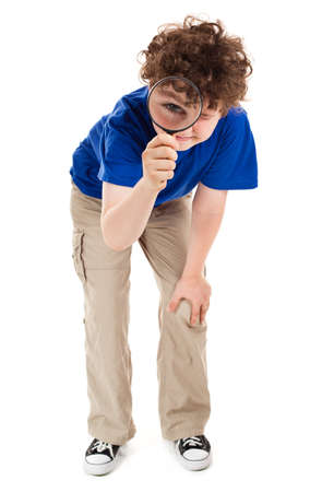 inspector kid: Boy looking through magnifying glass on white background  Stock Photo