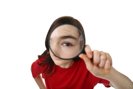 inspector kid: Young girl holding a magnifying glass