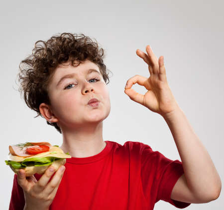 Boy eating a sandwich  photo