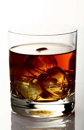 alcoholic beverage: Glass of whiskey on rocks  Stock Photo