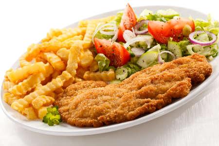 pork chop: Pork chop, french fries and vegetables