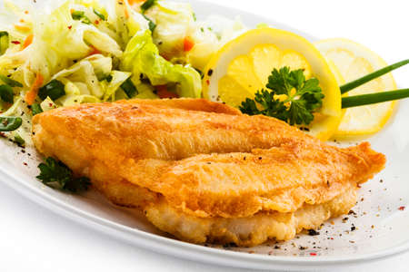 fried fish: Fried fish fillet with vegetables