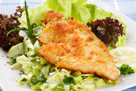 cooked fish: Fried fish fillet with vegetables