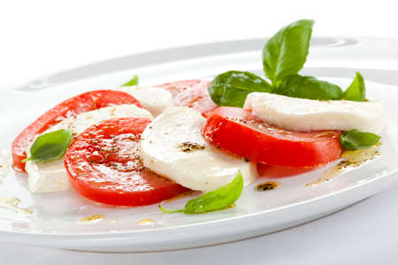lowfat: Close up of caprese salad on white background Stock Photo