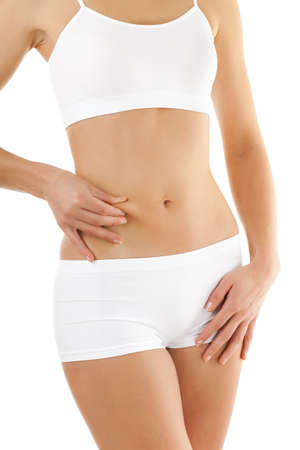 Slim woman pinching stomach on white background Stock Photo