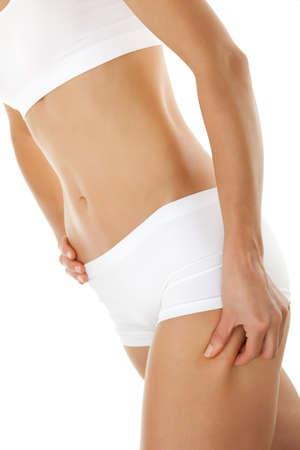 pinch: Slim woman pinching thigh on white background Stock Photo
