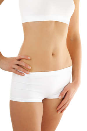 Close up of slim womans body on white background