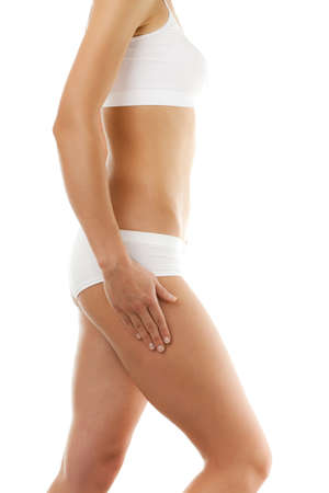 Side view of slim womans body on white background Stock Photo