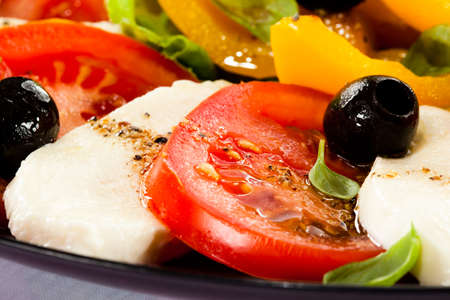 sliced cheese: Close up of caprese salad on white background Stock Photo