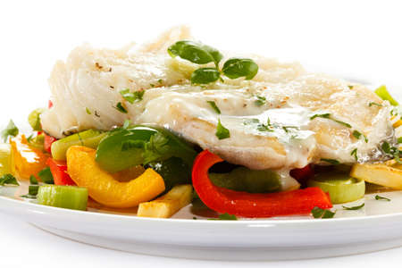 Boiled fish with bell peppers on white background photo