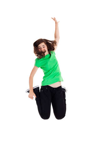 green clothes: Girl jumping on white background Stock Photo