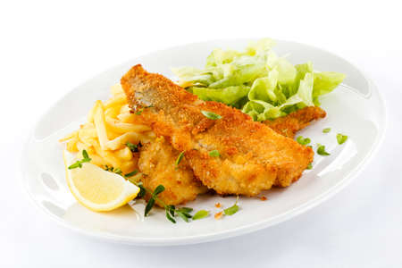 Fried fish fillet with chips and salad on white background Stock Photo