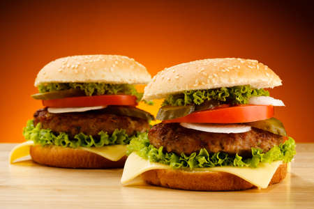 chicken burger: Two big hamburgers on table