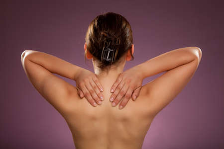 Woman massaging her neck and the side of her waist photo