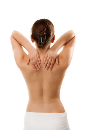 back  view: Woman massaging pain at the back of her neck