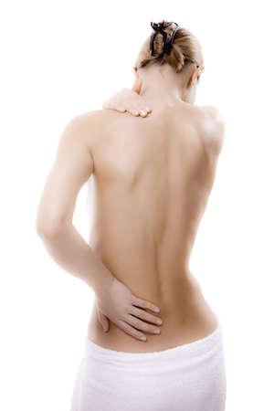 epaule douleur: Femme � lui masser le cou et le bas du dos Banque d'images