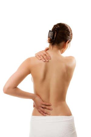 epaule douleur: Femme à lui masser le cou et le bas du dos Banque d'images