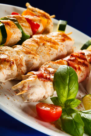 chicken grill: Grilled meat skewers with cucumbers
