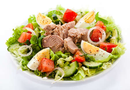 Tuna and vegetable salad on white background