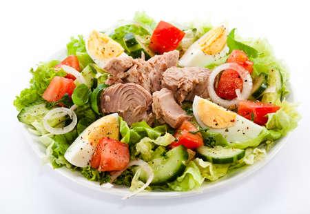salad greens: Tuna and vegetable salad on white background