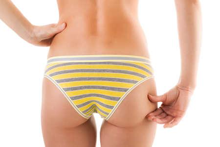 sexy woman panties: Slim woman pinching butt on white background