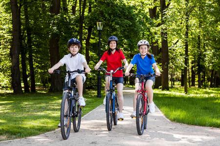 Family bike riding in park