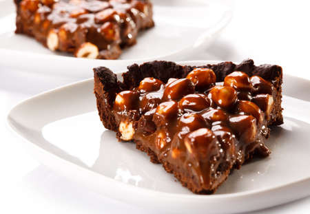 chocolaty: Close up two slices of hazelnut cake on white background Stock Photo