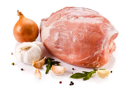 Raw pork with vegetables on white background Stock Photo