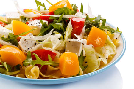 lowfat: Pasta with vegetable and cheese salad on white background Stock Photo