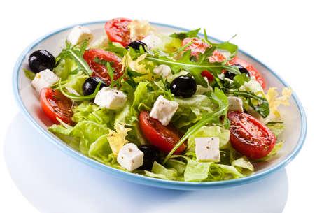 capsicums: Vegetable salad on white background