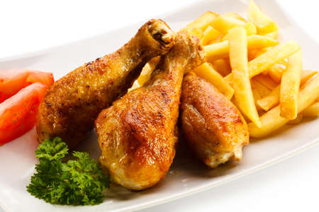 Roasted chicken drumsticks and french fries