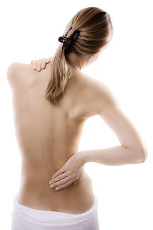 Woman massaging her shoulder and back photo