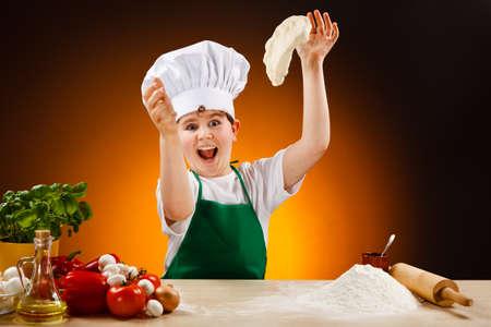 Boy making pizza dough photo