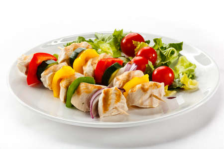 plates of food: Chicken kebab and vegetables Stock Photo