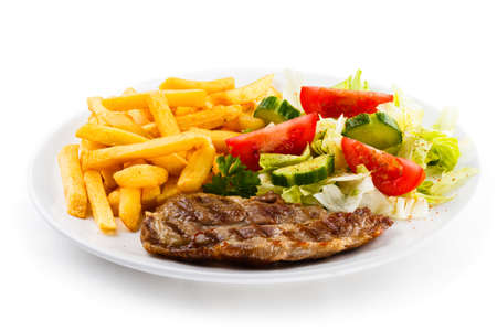 Grilled steak with chips and vegetables