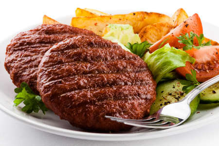 Grilled beefsteak with baked potatoes and vegetables photo