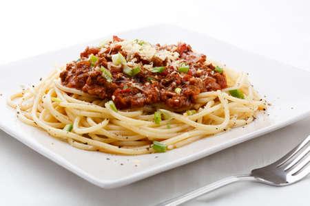 queso rallado: Espaguetis con salsa de carne picada