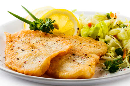 Fried fish fillet with vegetables photo