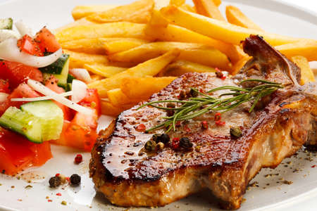 Grilled steak with chips and vegetables photo