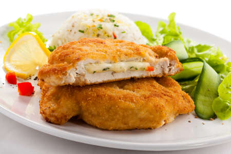schnitzel: Stuffed chicken fillet with rice and vegetables Stock Photo