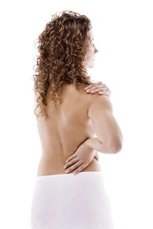 Woman massaging her back photo