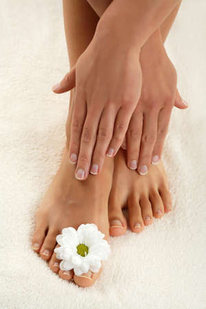 footcare: Close up of womans feet and hands Stock Photo