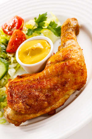 Roasted chicken leg and vegetables photo