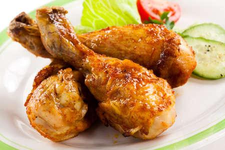chicken leg: Grilled chicken drumsticks and vegetables