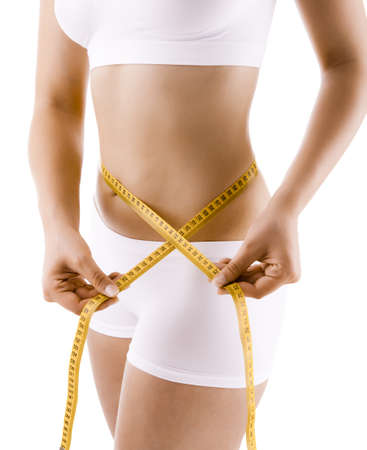 torso: Woman measuring her waist Stock Photo